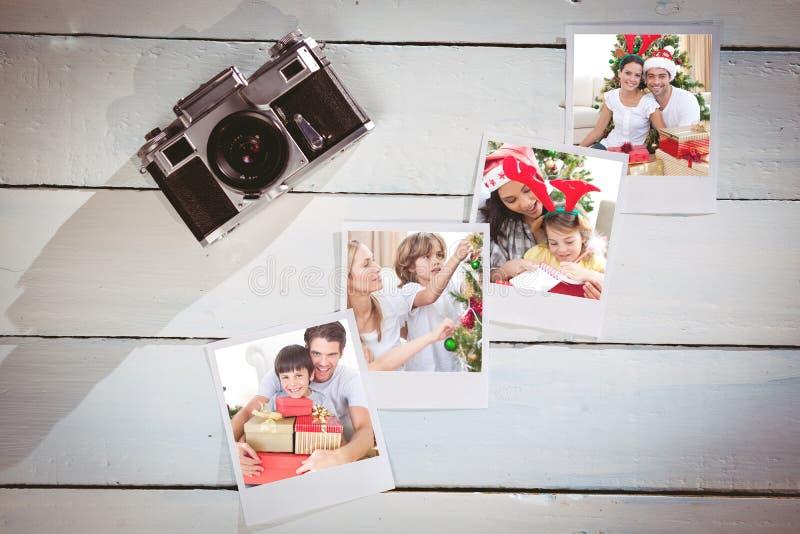 在家庆祝圣诞节的愉快的夫妇的综合图象 免版税库存照片