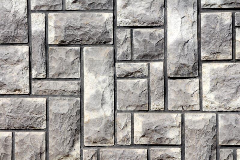 在家庭房子墙壁纹理背景墙纸的自然光石瓦片 免版税库存图片