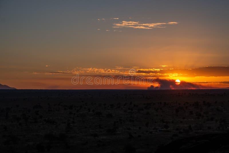 在察沃西部,肯尼亚的日落 免版税库存照片