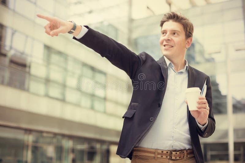 在对象的男性指向的手指 免版税库存照片