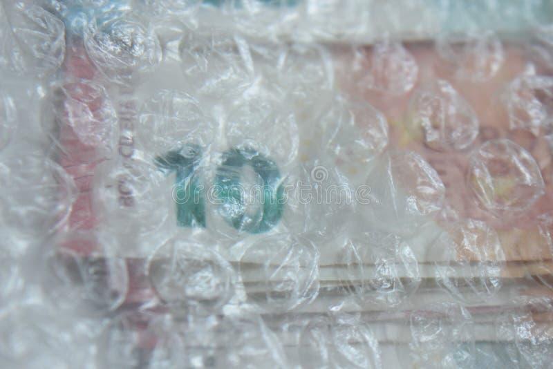 在小钞票的欧洲货币 库存照片