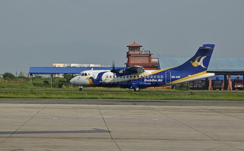 在尼泊尔特里布万国际机场的佛陀航空 免版税图库摄影