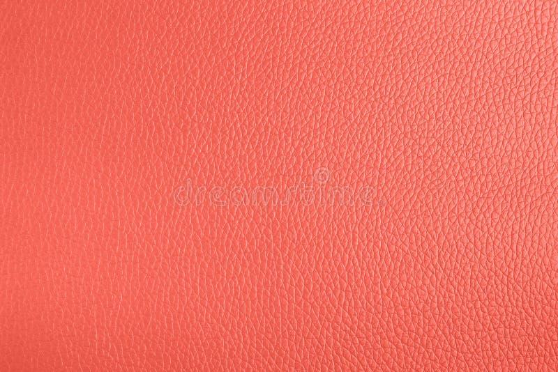 在居住的珊瑚颜色的皮革织地不很细背景 库存图片