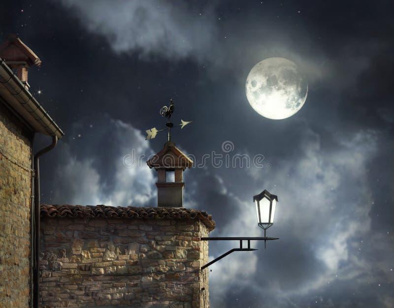 在屋顶上的夜 库存照片