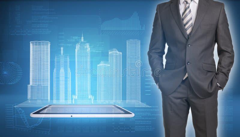 在屏幕上的商人和导线框架大厦 图库摄影