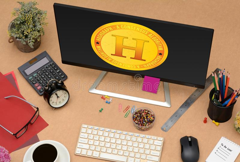 在屏幕上的新的Hashgraph硬币设计 免版税库存图片