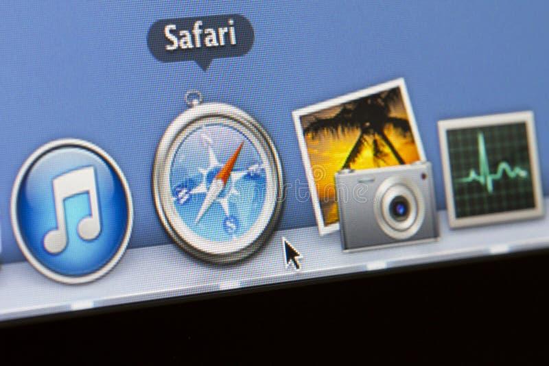在屏幕上的苹果计算机象 库存照片