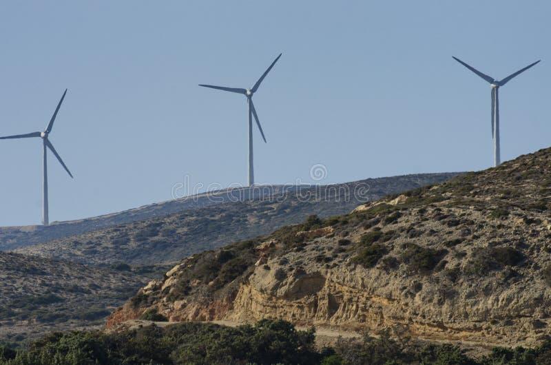 在山的三台风轮机 免版税库存图片