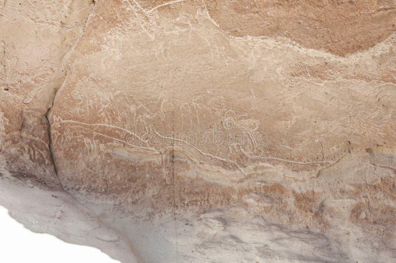 在岩石的古老刻在岩石上的文字在Yerbas Buenas在阿塔卡马沙漠在智利 免版税库存照片