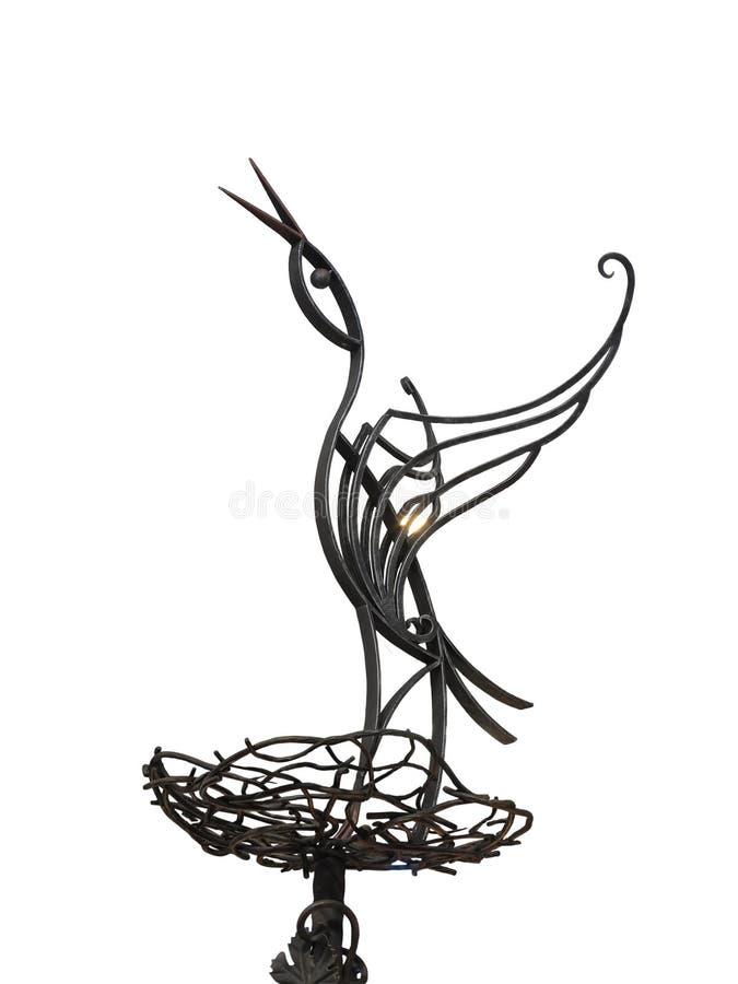 在巢的抽象金属伪造的鹳被隔绝在白色 图库摄影