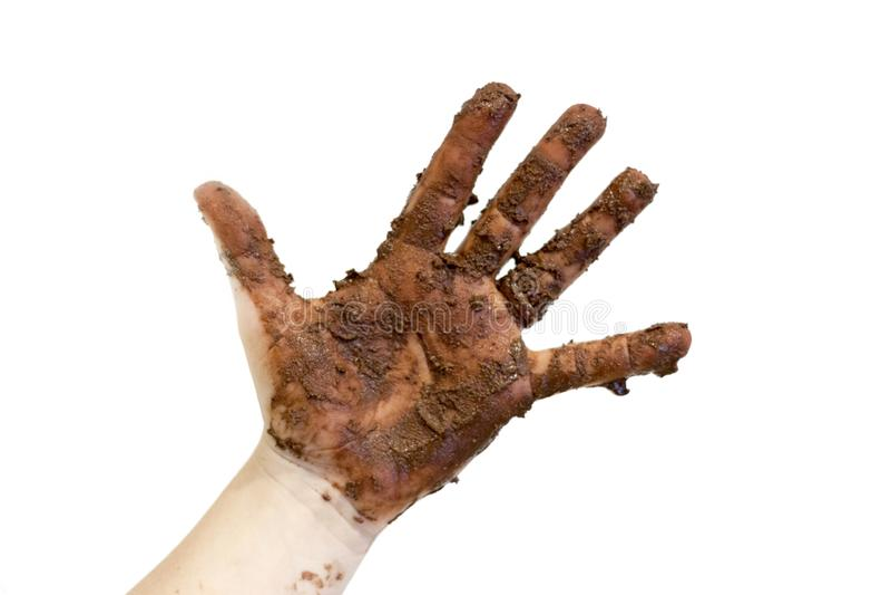 在巧克力或泥报道的手 库存照片