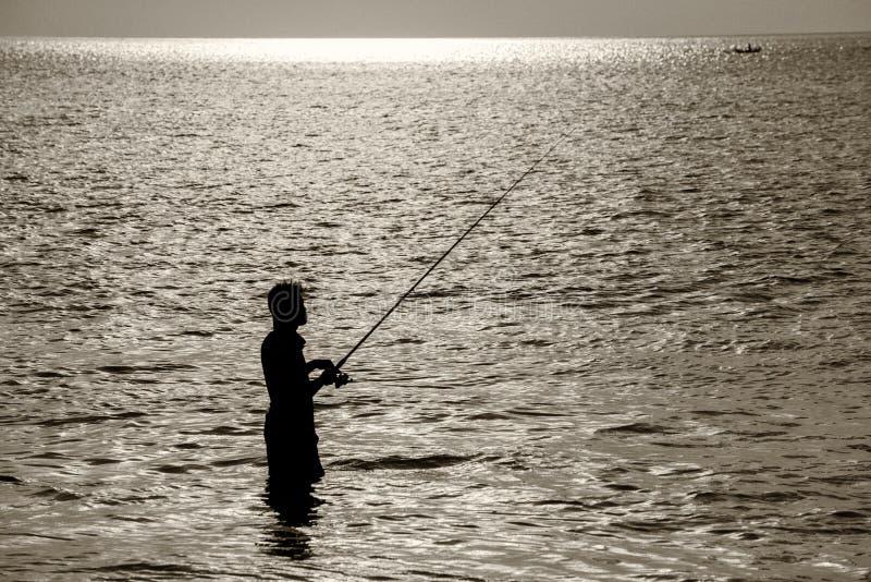 在巴厘岛日落期间的Jimbaran海滩 免版税库存图片