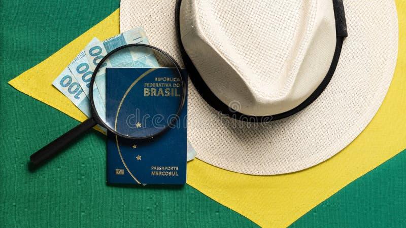 在巴西旗子背景的巴西护照 库存照片