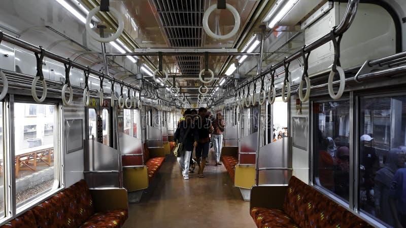 在市郊火车里面的乘客在雅加达甲田驻地 库存照片