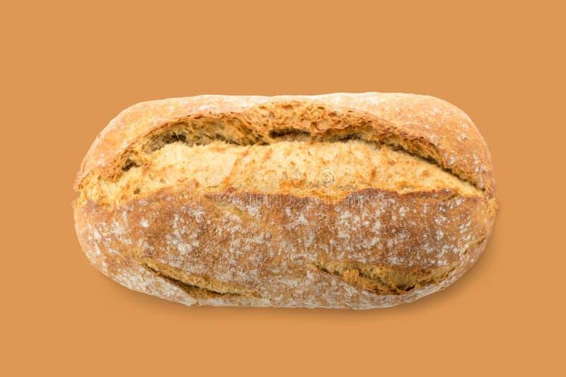 在布朗背景的自创整个传统面包 免版税库存照片