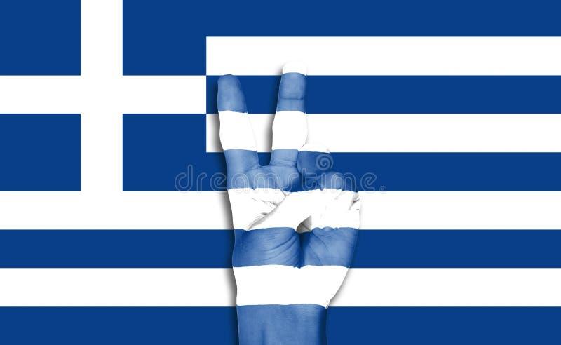 在希腊旗子背景的手 库存图片