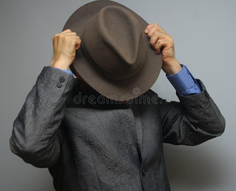 在帽子之后 库存图片