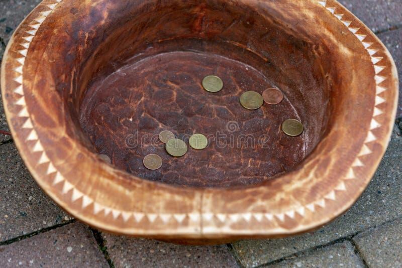 在帽子赢得的硬币 库存照片