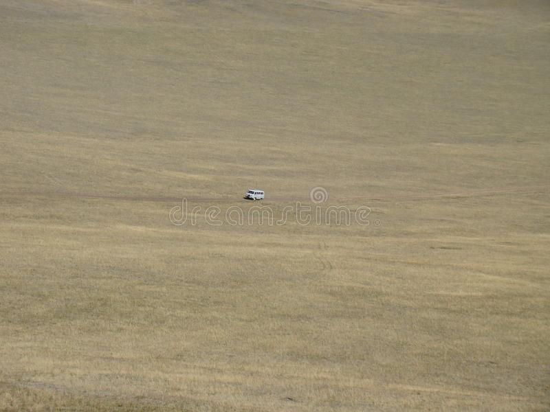 在平原的汽车 图库摄影