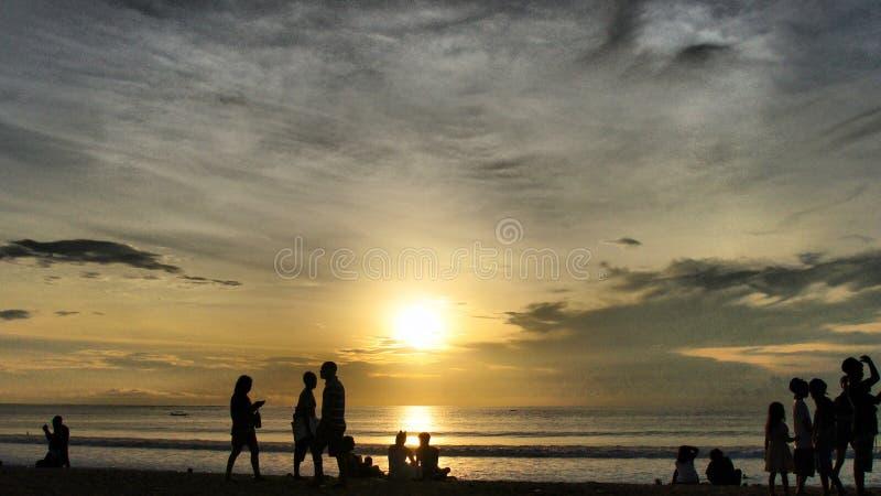 在库塔海滩,巴厘岛的日落 免版税库存照片