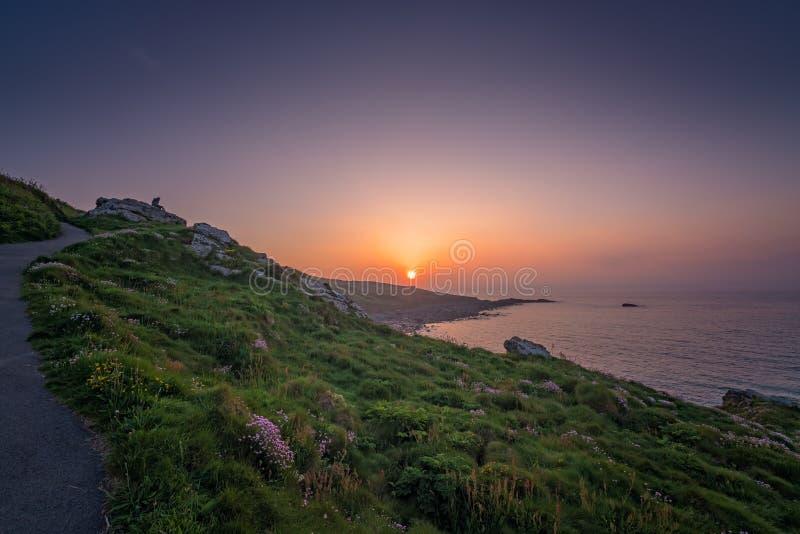 在康沃尔海岸的日落 库存照片