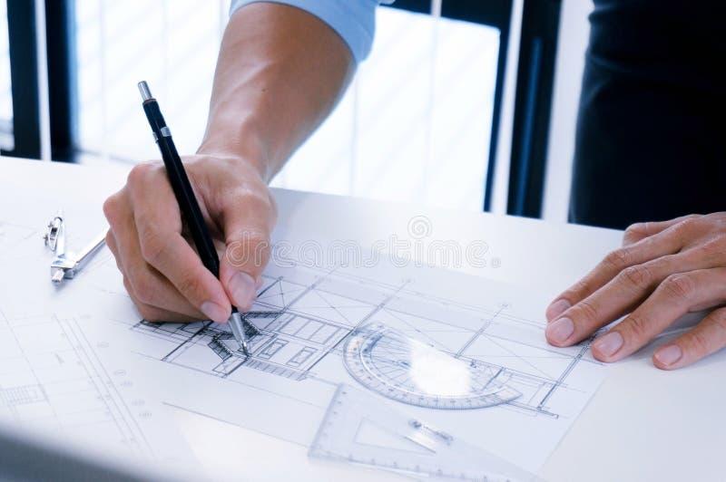 在建筑项目企业建筑师的建筑学图画 库存照片