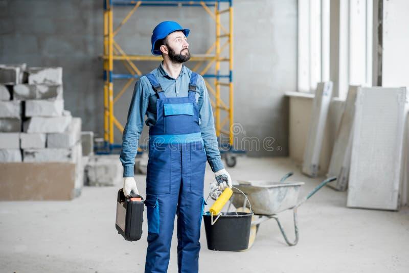 在建造场所的建造者 免版税库存照片