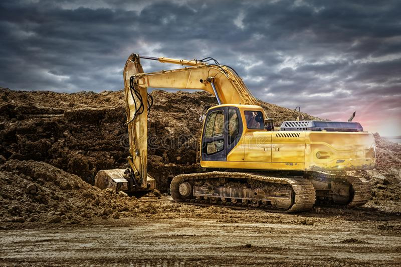 在建造场所的挖掘机机械 图库摄影