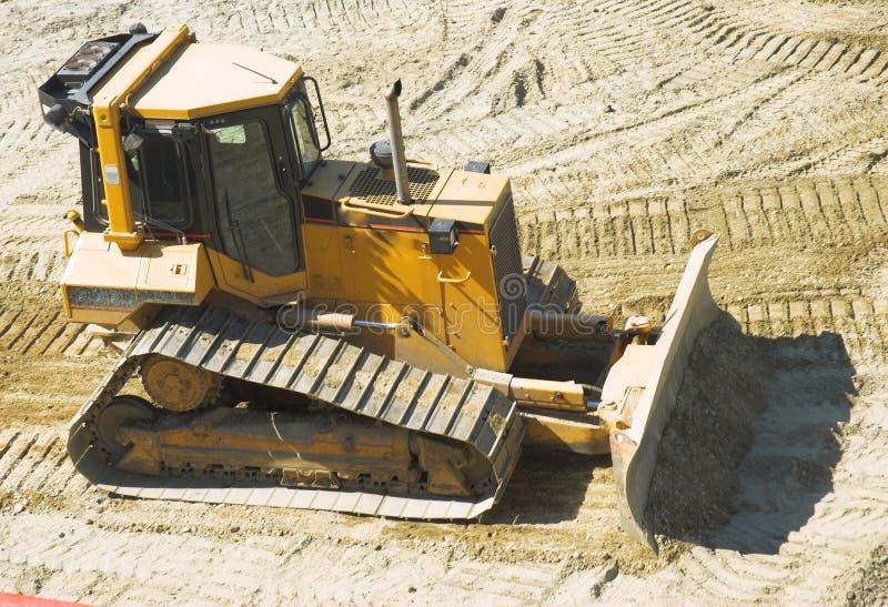 在建造场所的推土机 免版税图库摄影