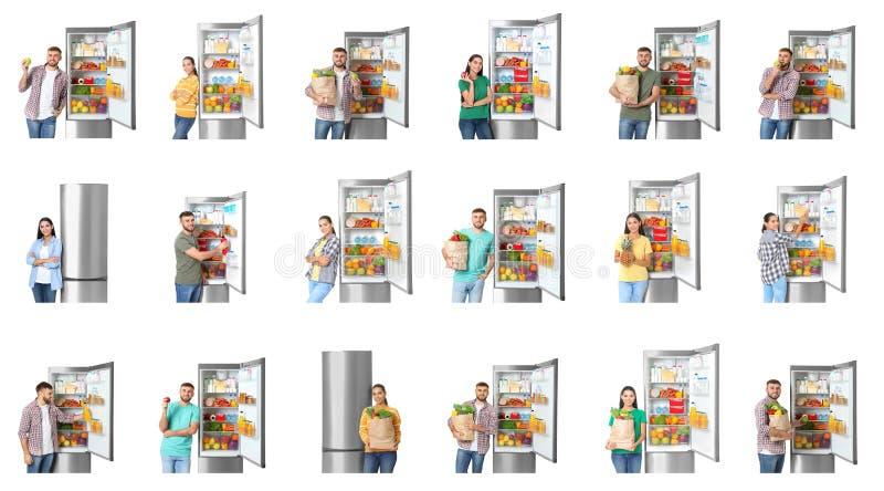 在开放冰箱附近的年轻人在白色 免版税库存照片