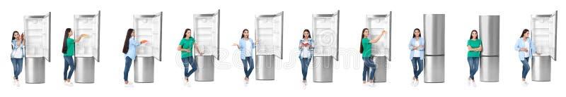在开放冰箱附近的年轻人在白色 免版税图库摄影