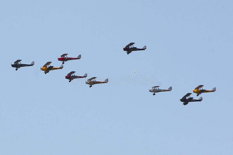 在形成的九个灯蛾航空器飞行 库存图片