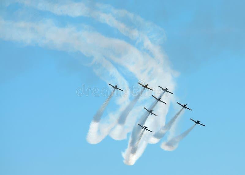 在形成的特技飞机 免版税库存图片
