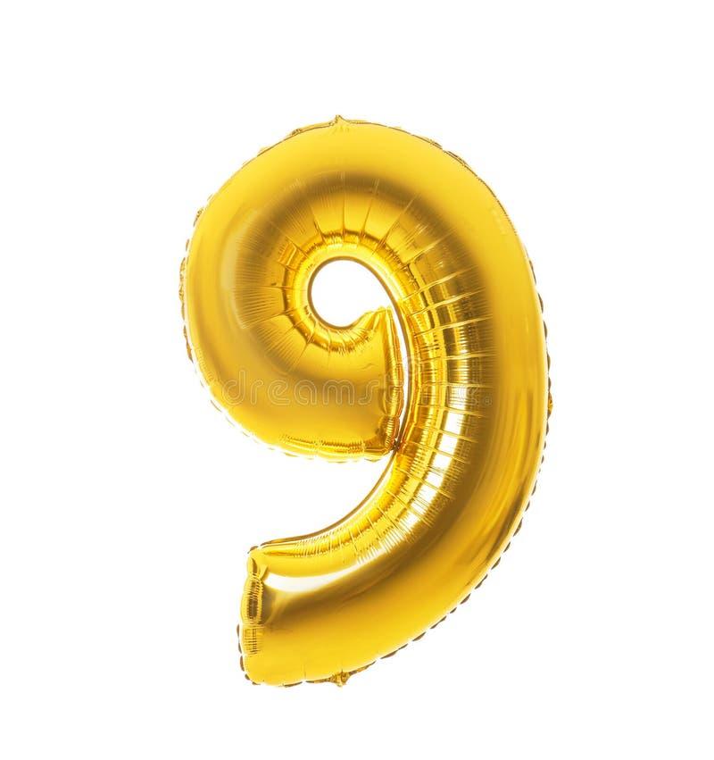 在形状的金黄气球在白色背景的图九 库存照片