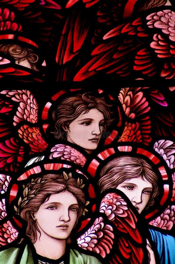 在彩色玻璃的三个天使 皇族释放例证