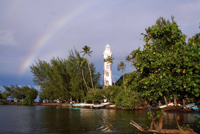 在彩虹的灯塔 图库摄影