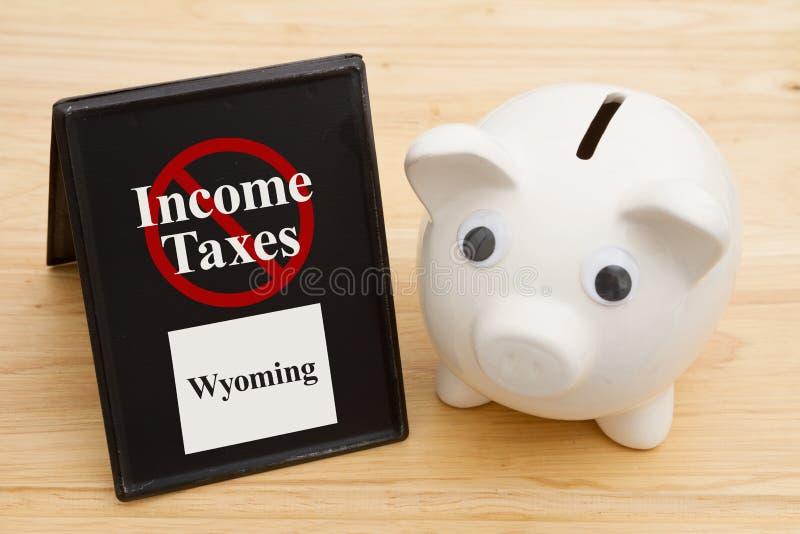 在怀俄明消息状态的没有所得税与存钱罐的 免版税库存图片