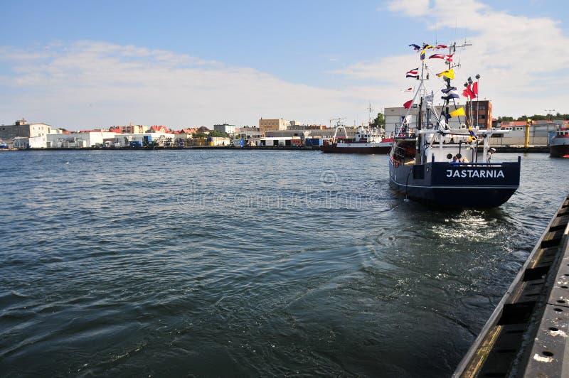在恶劣环境测井口岸的小船 库存图片