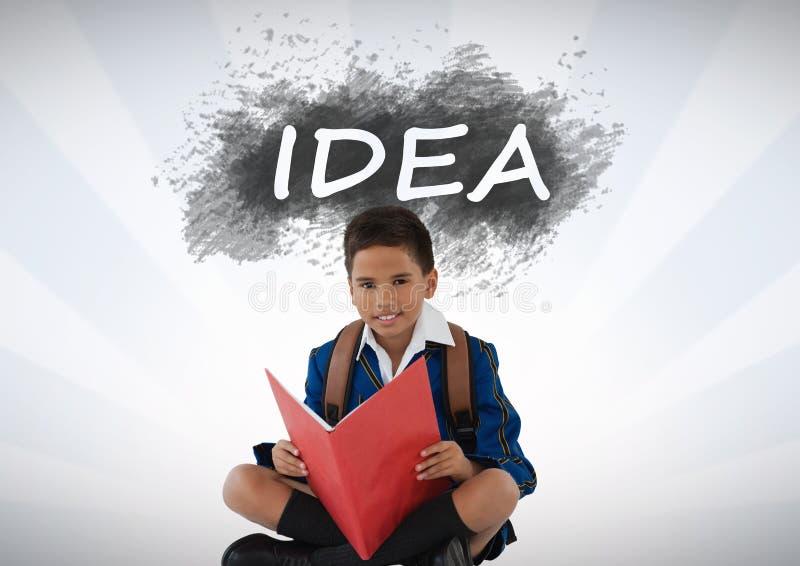 在想法文本下的男小学生读书 免版税图库摄影