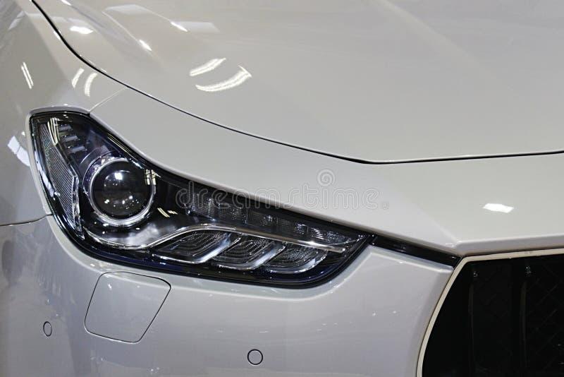 在意大利现代豪华体育exlusive汽车的LED车灯 免版税图库摄影