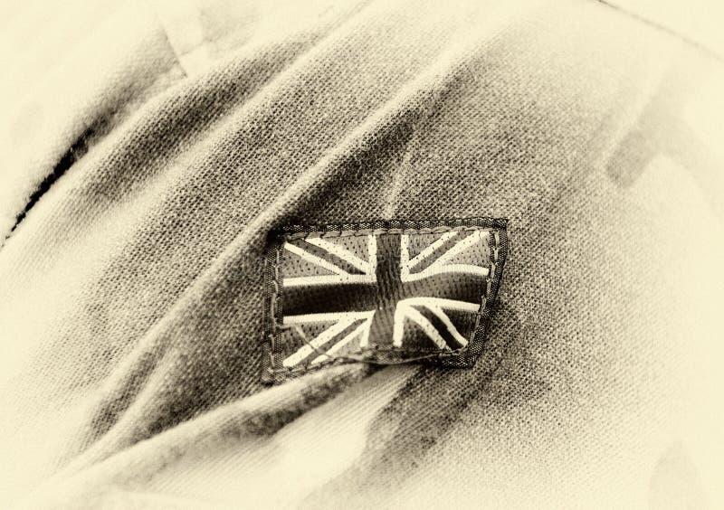 在战士的英国补丁旗子武装 英国军服 团结的Kingd 免版税图库摄影