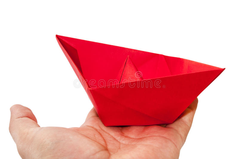 在手上的红色origami小船 免版税库存照片