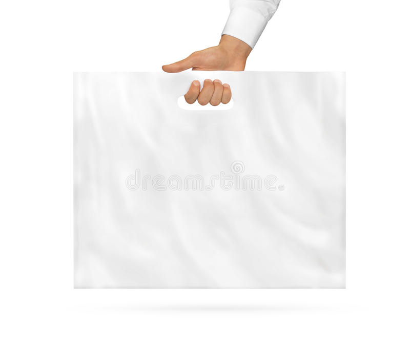在手中举行大空白的塑料袋的嘲笑  大空的聚乙烯包裹 免版税图库摄影