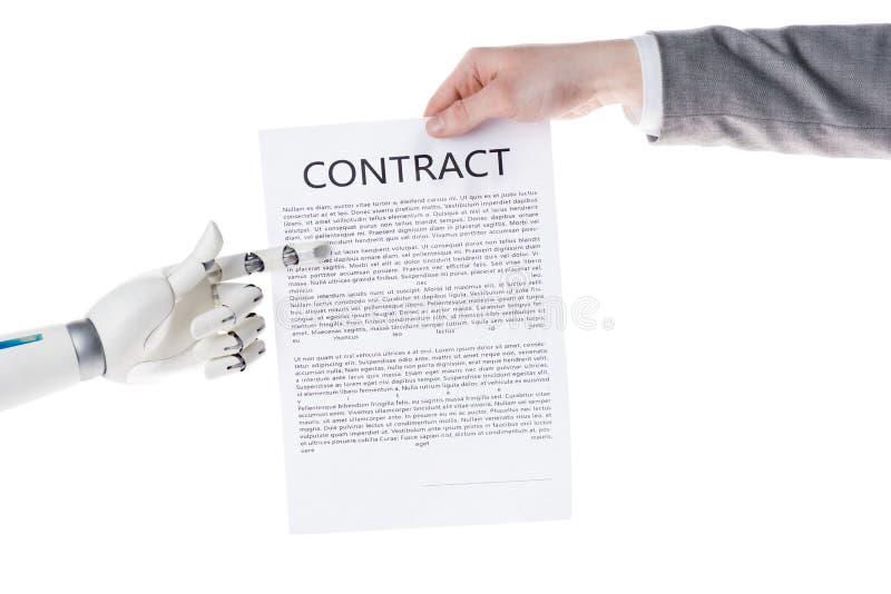 在手中指向企业合同的机器人播种的射击商人 免版税库存图片