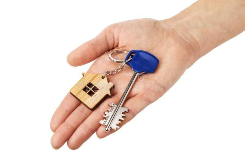 在手中被隔绝的公寓的钥匙 免版税库存图片