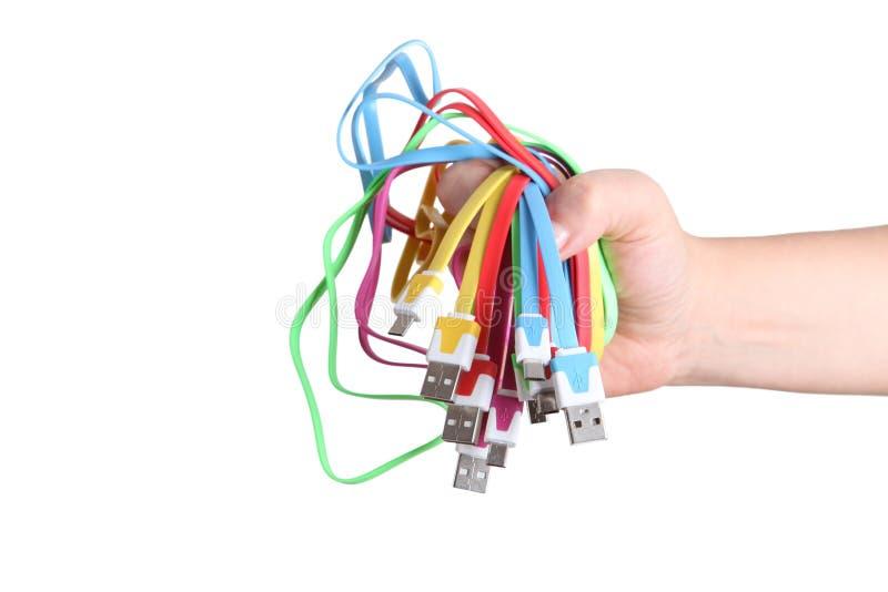 在手中被隔绝的计算机缆绳 免版税库存图片