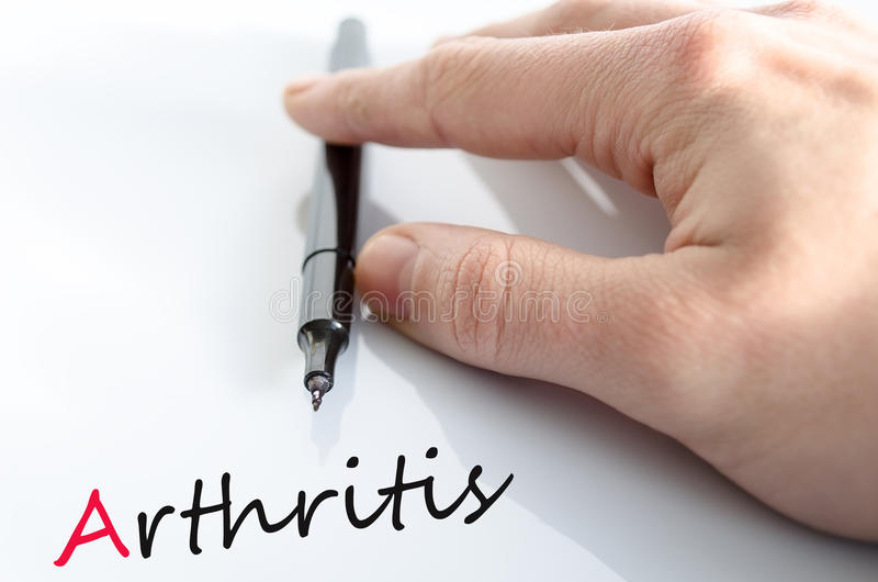 在手关节炎概念的笔 库存照片