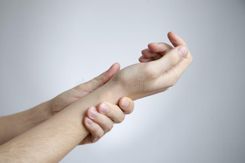 在手的联接的痛苦 库存图片