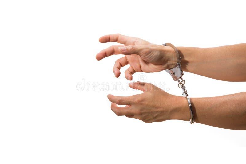 在手铐的男性手,白色隔绝了背景 免版税库存照片