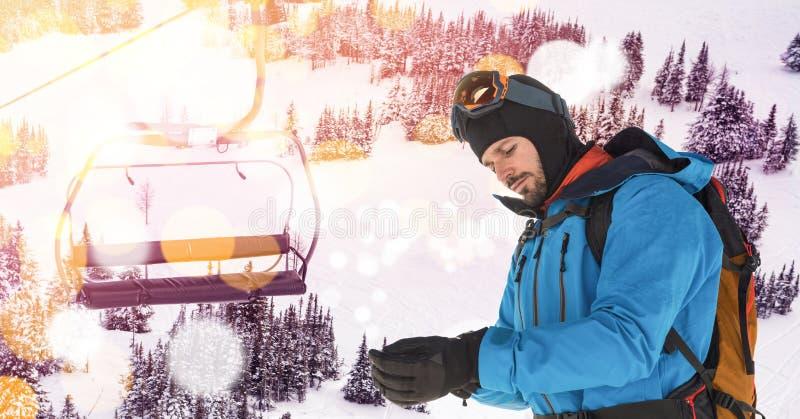 在投入在手套的倾斜的人滑雪 库存图片